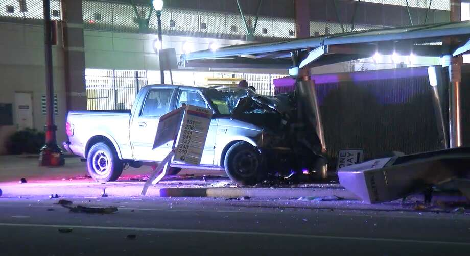 A woman impaled her pickup truck on a Metro bus stop early Sunday after driving the wrong way down a downtown Houston street at a high speed, according to police and witnesses. Photo: On Scene