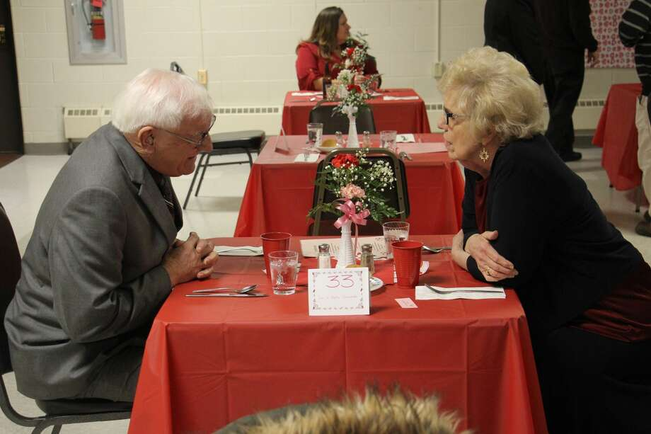 Marriedcouplesenjoy aromantic Valentine's dinner with friends atOswaldHall of St. Hubert Catholic Church. Photo: Sara Eisinger/Huron Daily Tribune
