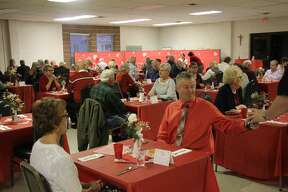 Married couples enjoy a romantic Valentine's dinner with friends at Oswald Hall of St. Hubert Catholic Church.