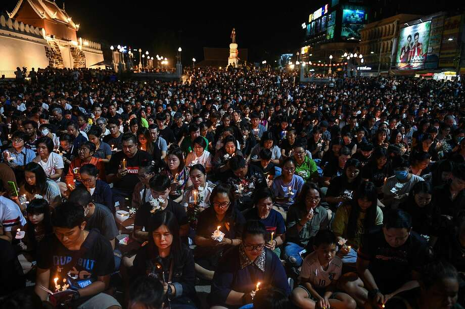 Residents fill the town square of Nakhon Ratchasima for a candlelight vigil in honor of the victims of the shooting rampage. The attack killed 29 people and wounded 58 others. Photo: Chalinee Thirasupa / AFP / Getty Images