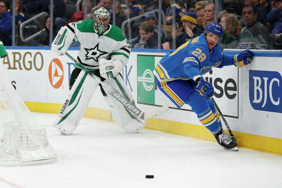 The Blues' Mackenzie MacEachern (right) and Stars goaltender Anton Khudobin watch the puck during the second period Saturday night in St. Louis.