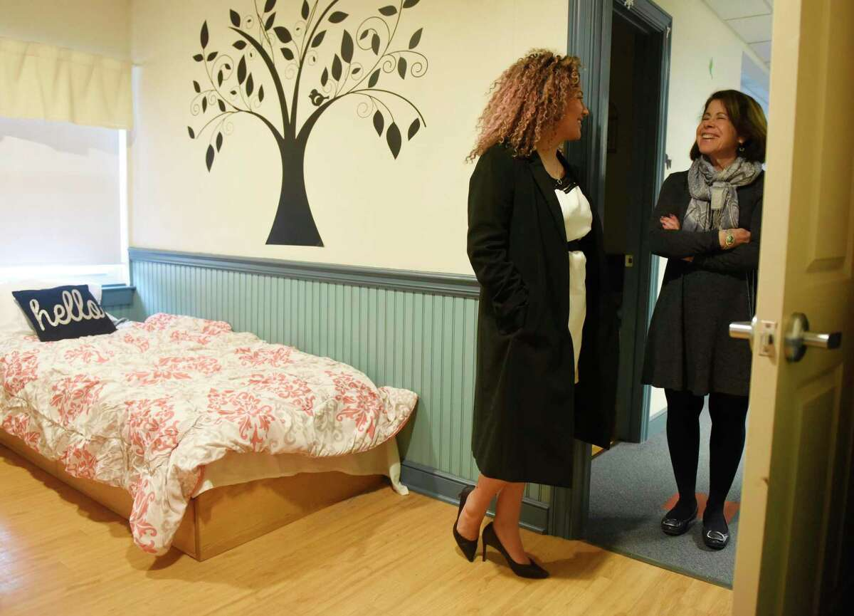 """Norwalk resident Brina Rodriguez, left, recalls memories with Executive Director Shari Shapiro while visiting her old room at Kids in Crisis in the Cos Cob section of Greenwich, Conn. Tuesday, Feb. 4, 2020. Rodriguez ran away from home at age 14 and was referred to Kids In Crisis, where she stayed for six weeks and turned her life around. She is now the founder of SOLUDE Coffee, which features a """"Coffee for Causes"""" program that gives back to the community with every coffee purchase."""