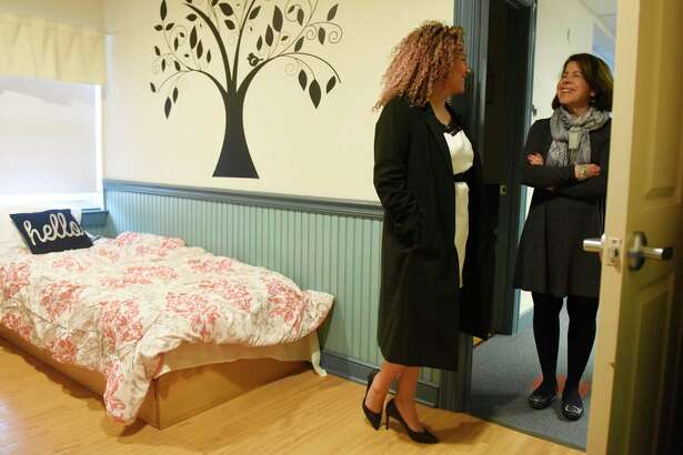 "Norwalk resident Brina Rodriguez, left, recalls memories with Executive Director Shari Shapiro while visiting her old room at Kids in Crisis in the Cos Cob section of Greenwich, Conn. Tuesday, Feb. 4, 2020. Rodriguez ran away from home at age 14 and was referred to Kids In Crisis, where she stayed for six weeks and turned her life around. She is now the founder of SOLUDE Coffee, which features a ""Coffee for Causes"" program that gives back to the community with every coffee purchase."