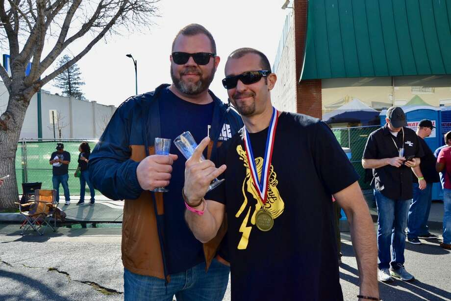 Zack Frasher (R) and Slice co-owner Russ Yeager (L) celebrates Slice Beer Co.'s win at the Bistro's 20th Annual Double and Triple IPA Festival on Saturday, February 8, 2020. Photo: Alyssa Pereira / SFGATE