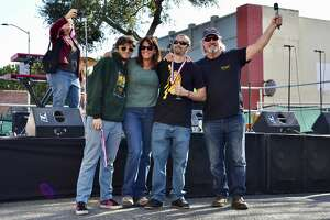 Zack Frasher (with medal) celebrates his win with Cynthia Kralj (second from left) and Vic Kralj (far right) at the Bistro's 20th Annual Double and Triple IPA Festival on Saturday, February 8, 2020.