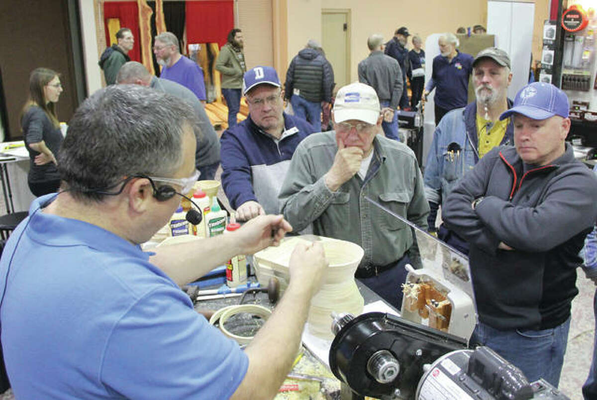 Demonstrator Peter Merrett gives some tips to attendees at the St. Louis Woodworking Show Friday at the Gateway Convention Center in Collinsville. The show continues Saturday and Sunday, and is expected to draw more than 5,000 woodworking enthusiasts.