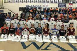The 20 honorees on the All-FCIAC cheerleading team pose for a picture at the end of the conference championship meet in Wilton on Saturday, Feb. 8, 2020. From left, front row, Gabriella Gonzalez (Stamford); Paige Chen (Warde); Alanna Smith (Danbury); Kyla Gonzalez (Greenwich); Nina Sophie Masi (Ridgefield); Amanda Sklar (Wilton); Gabby Russo (St. Joseph); Rebecca Roll (Ludlowe); Josie Marshall (McMahon); and Jenna D'Amico (St. Joseph); back row, Emma Kortmansky (Ludlowe). Ali Mills (McMahon); Fashanti Lee (McMahon); Molly Butler (St. Joseph); Ella Thompson (Staples); Avery Marquis (Danbury); Alex Kral (male on Greenwich Co-ed team); Avery Banks (Greenwich); Jenny Bradshaw (Staples); and Avery Wallace (Staples).