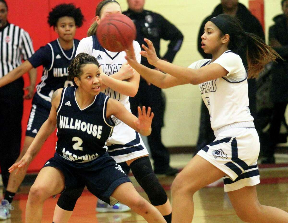 Notre Dame of Fairfield's Erin Harris (3) passes the ball as Hillhouse's Ciara Little (2) defends during CIAC Class L girls basketball tournament action in Monroe, Conn., on Friday Mar. 8, 2019.
