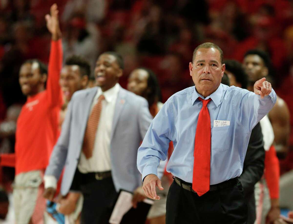 Houston head coach Kelvin Sampson, right, points to a player after a Cougars' three point basket during the first half of an NCAA college basketball game against Wichita State, Sunday, Feb. 9, 2020, in Houston.
