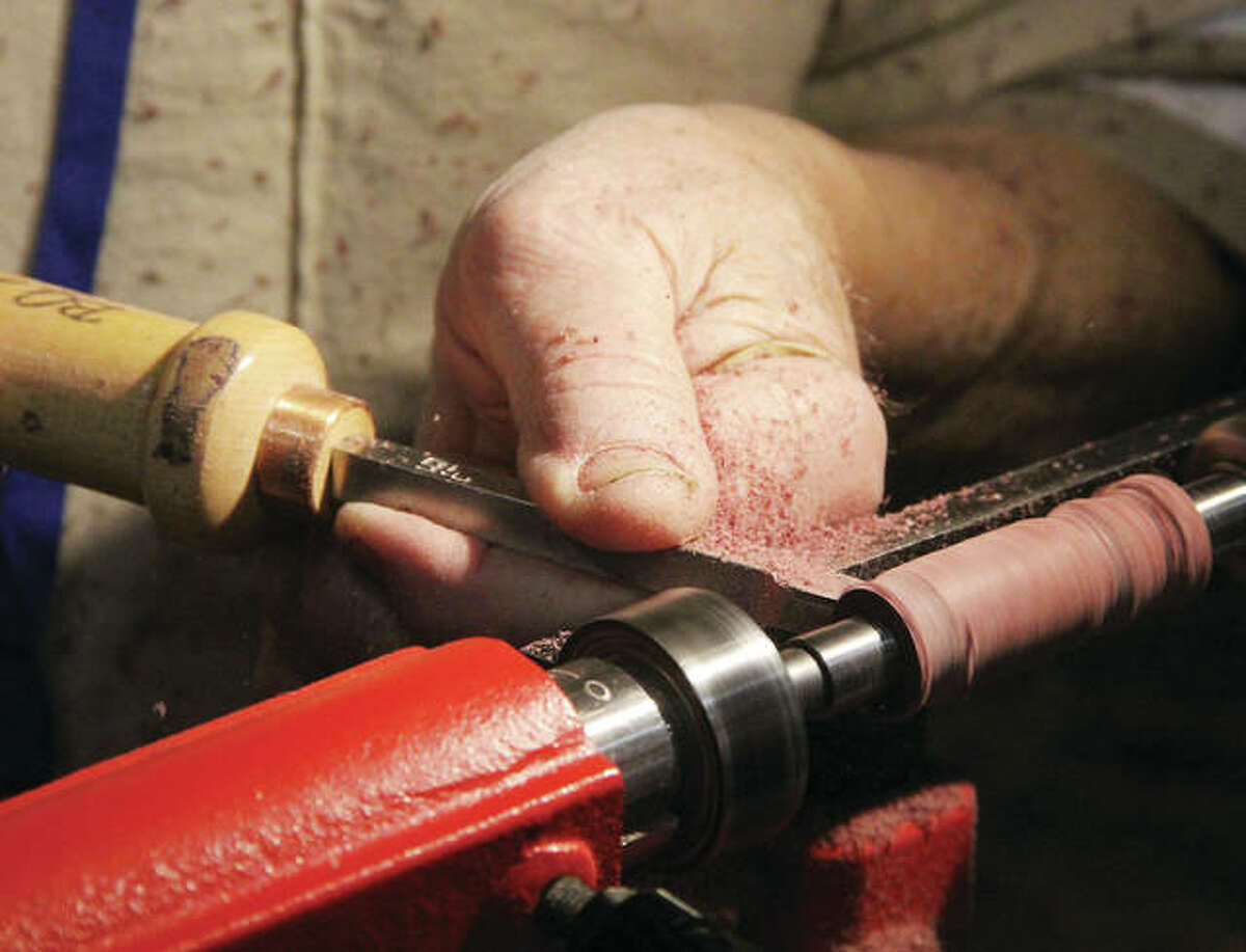 Frank Aldridge, of Granite City, a member of the Edwardsville Woodworkers Club, uses a chisel and lathee to turn a pen as part of a fundraiser for the Wounded Warrior Project at the St. Louis Woodworking Show Friday at the Gateway Convention Center in Collinsville. The show continues Saturday and Sunday, and is expected to draw more than 5,000 woodworking enthusiasts.