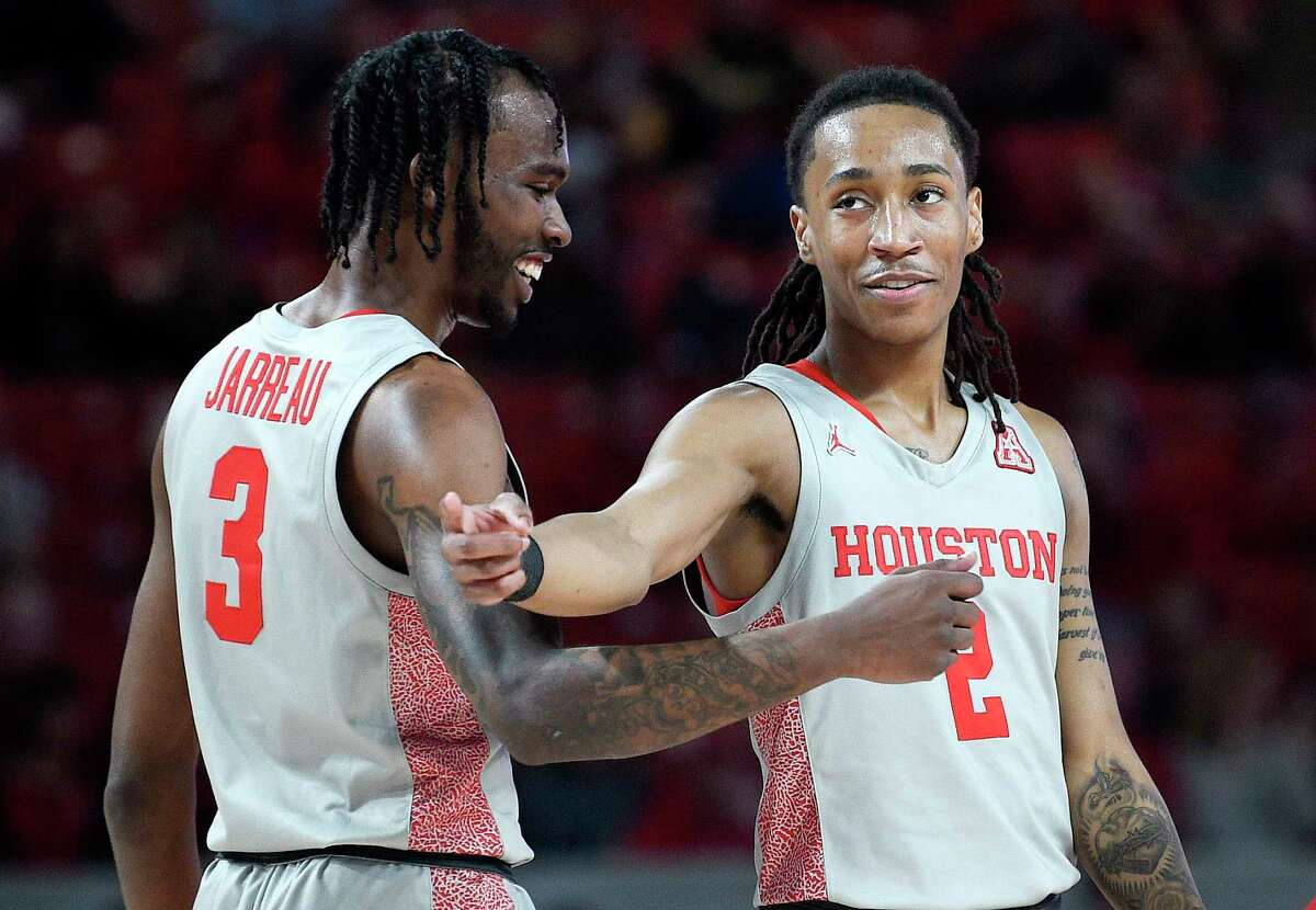 Houston guard Caleb Mills (2) celebrates his basket with guard DeJon Jarreau during the first half of an NCAA college basketball game against Wichita State, Sunday, Feb. 9, 2020, in Houston.