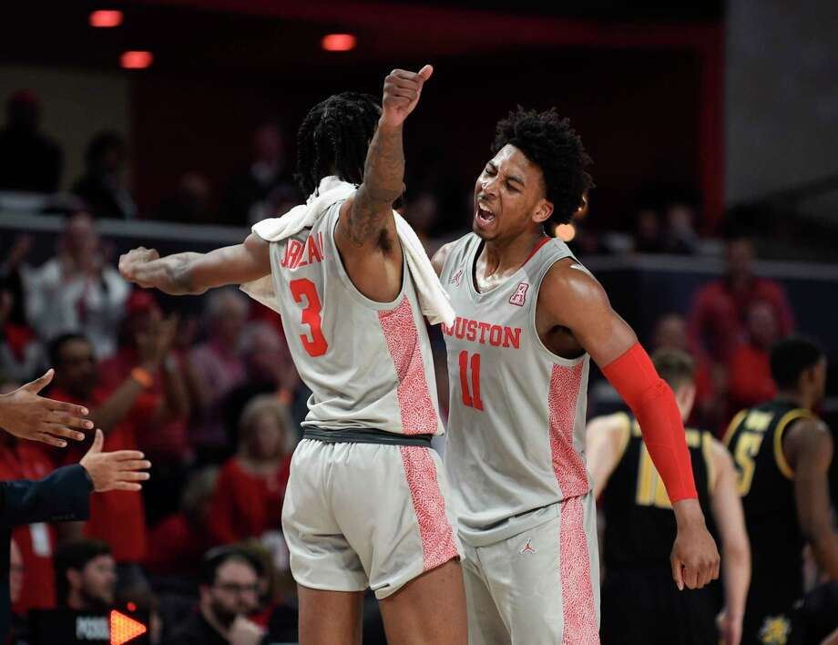 UH's Nate Hinton (11) and teammate DeJon Jarreau had plenty to celebrate during Sunday's obliteration of Wichita State at Fertitta Center. Photo: Eric Christian Smith, Contributor / Houston Chronicle