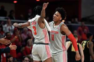 Houston guard Nate Hinton (11) and guard DeJon Jarreau celebrate during a timeout during the second half of an NCAA college basketball game against Wichita State, Sunday, Feb. 9, 2020, in Houston.