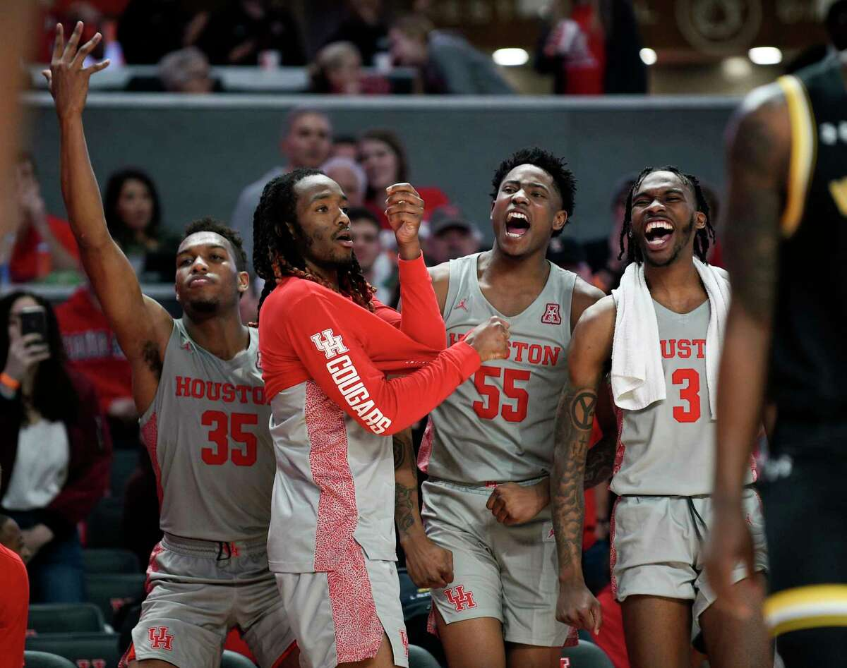 Houston center Brison Gresham (55) and teammates celebrate a Cougars' basket from the bench during the second half of an NCAA college basketball game against Wichita State, Sunday, Feb. 9, 2020, in Houston.