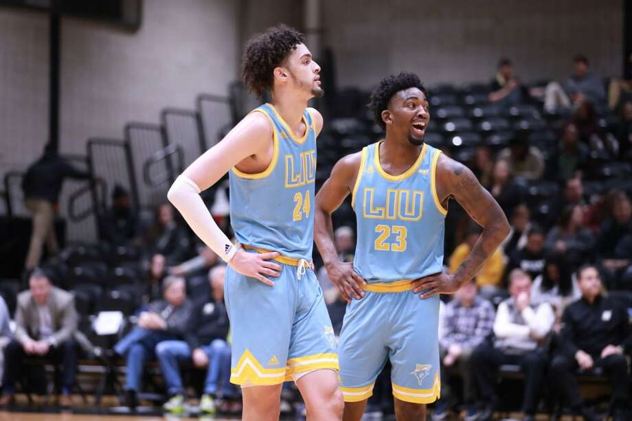 Waterbury's Ty Flowers,left, and New Haven's Raiquan Clark turned in historic performances for LIU on Saturday night. Photo: LIU Athletics / Contributed Photo