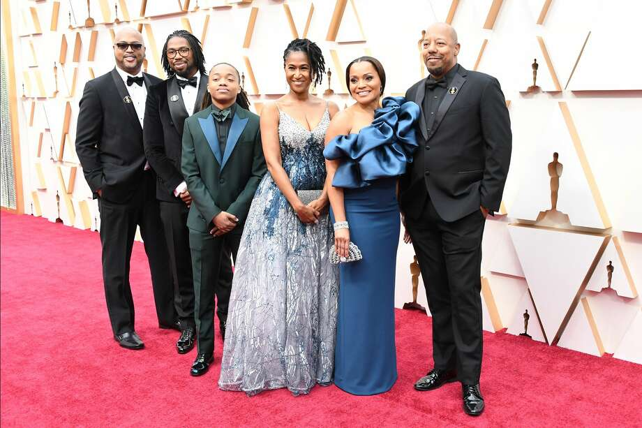 HOLLYWOOD, CALIFORNIA - FEBRUARY 09: US director Matthew A. Cherry (2nd L) US producer Karen Rupert Toliver (3rd R) and Deandre Arnold (3rd L), the Texas teen who was told his dreadlocks violated school dress code, attend the 92nd Annual Academy Awards at Hollywood and Highland on February 09, 2020 in Hollywood, California. (Photo by Steve Granitz/WireImage) Photo: Steve Granitz/WireImage, Getty Images