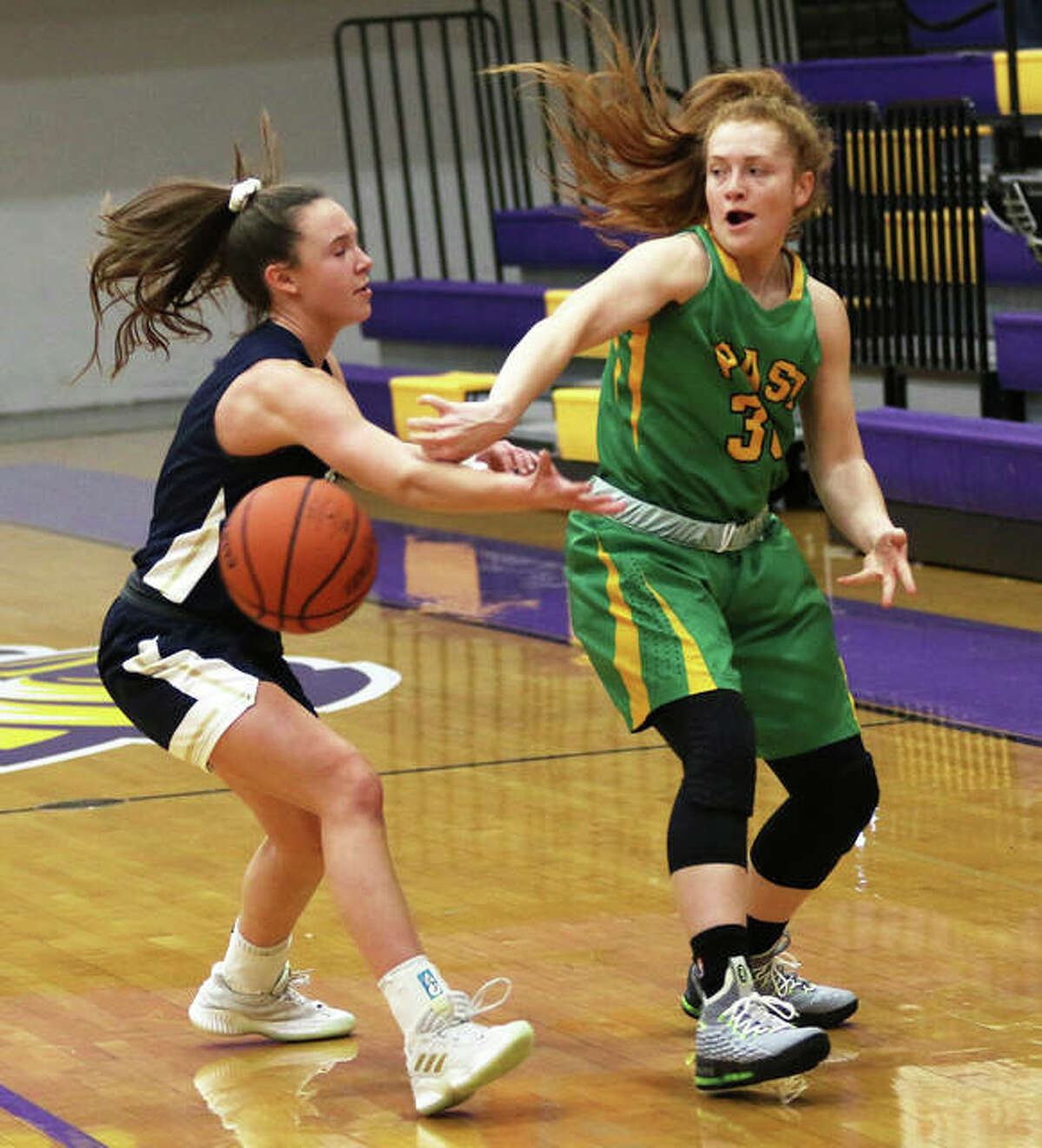 Southwestern's Rylee Smith (right) delivers a back-handed pass against a Quincy Notre Dame defender in a Dec. 21 shootout at Bethalto. Smith and the 18-10 Piasa Birds open Class 2A regional play Monday in Carlyle.