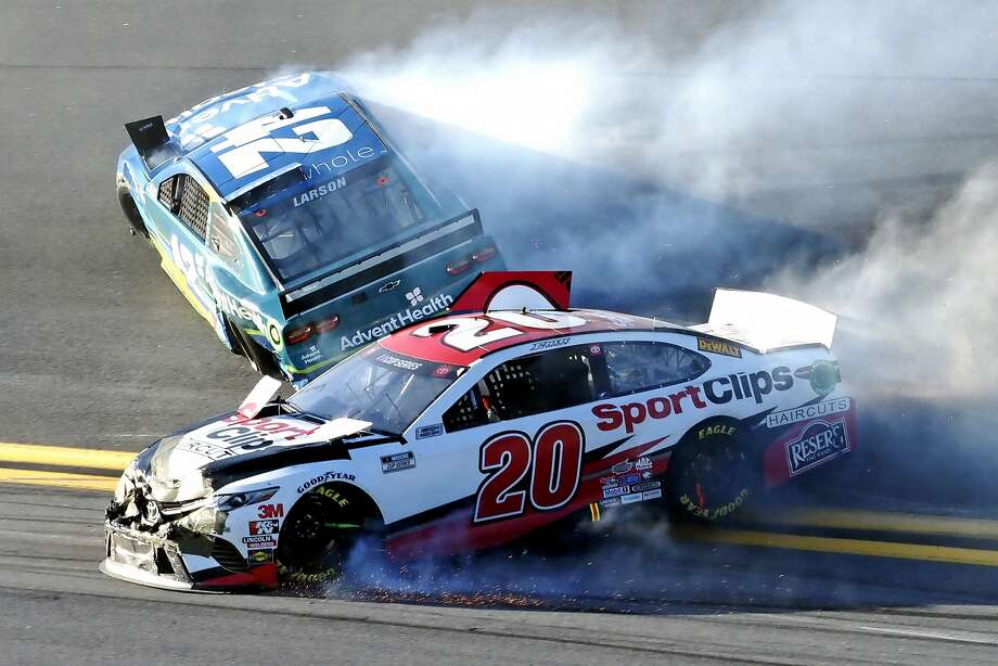 Erik Jones (20) and Kyle Larson (42) wreck going through Turn 4 in the Busch Clash at Daytona International Speedway. Photo: Darryl Graham / Associated Press