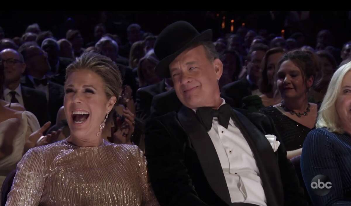 """Tom Hanks just moments after Janelle Monae gave him her hat during her jazzy rendition of """"Won't You Be My Neighbor?"""""""