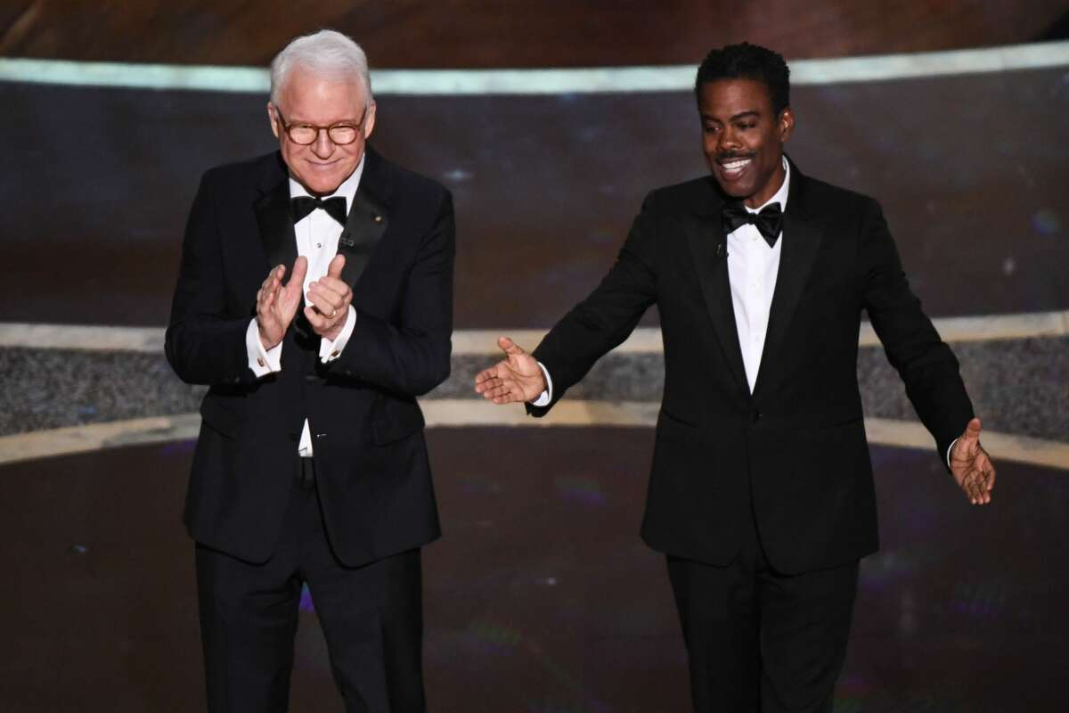 Steve Martin and Chris Rock (R) speak onstage during the 92nd Oscars at the Dolby Theatre in Hollywood, California on February 9, 2020.