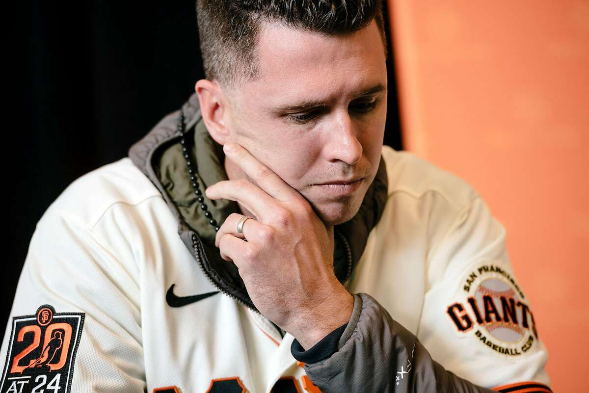 Buster Posey looks on during the San Francisco Giants Fan Fest event at Oracle Park in San Francisco, California, U.S., on Saturday, Feb. 8, 2020.