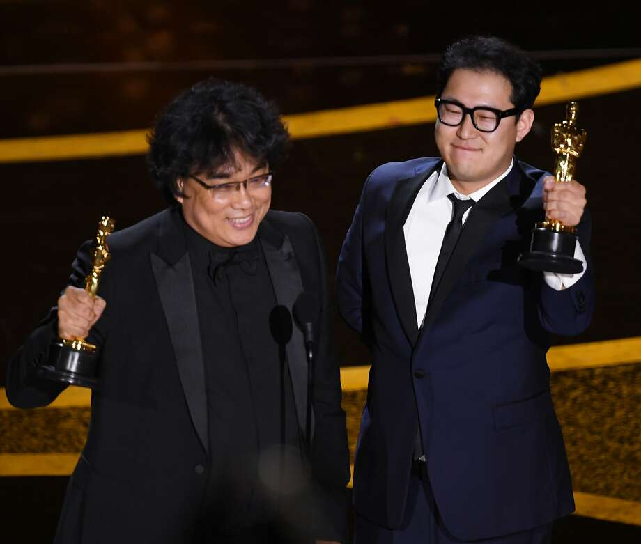 (L-R) Bong Joon-ho and Han Jin-won accept the Writing - Original Screenplay - award for 'Parasite' onstage during the 92nd Annual Academy Awards at Dolby Theatre on February 09, 2020 in Hollywood, California. (Photo by Kevin Winter/Getty Images) Photo: Kevin Winter, Getty Images