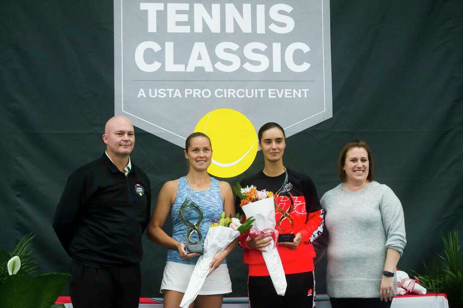 Shelby Rogers of the USA, center left, and Anhelina Kalinina of Ukraine, center right, pose for a photo with tournament officials during the award ceremony for the Dow Tennis Classic singles tournament Sunday, Feb. 9, 2020 at the Greater Midland Tennis Center. Kalinina forfeited the match to Rogers due to an injury. (Katy Kildee/kkildee@mdn.net)