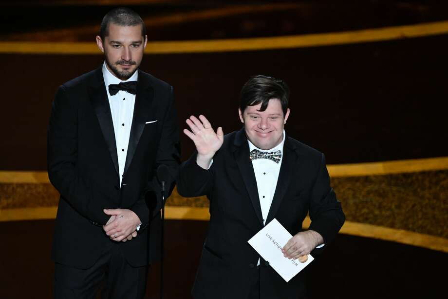 US actor Shia LaBeouf (L) and Zack Gottsagen speak onstage during the 92nd Oscars at the Dolby Theatre in Hollywood, California on February 9, 2020. (Photo by Mark RALSTON / AFP) (Photo by MARK RALSTON/AFP via Getty Images) Photo: MARK RALSTON/AFP Via Getty Images