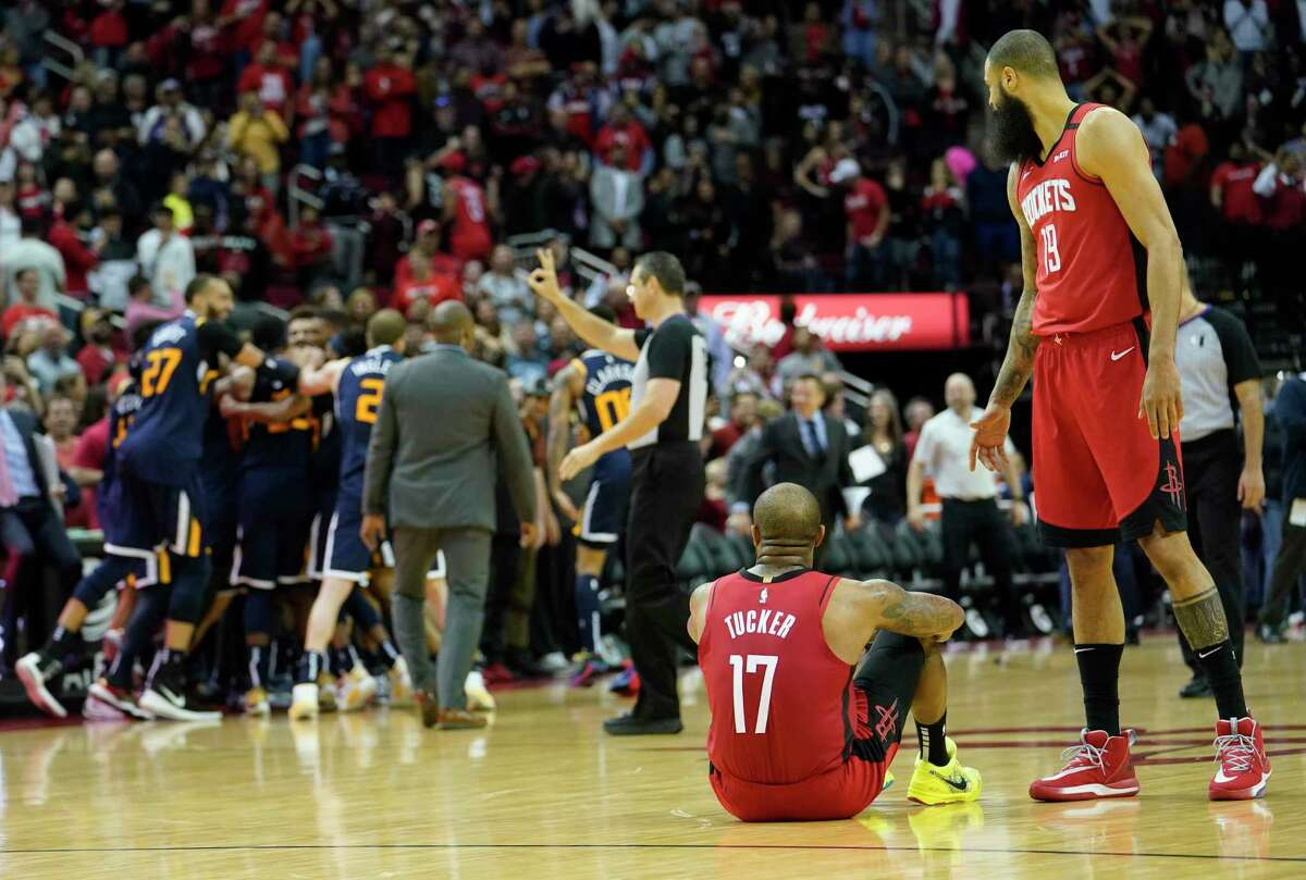 Houston Rockets P.J. Tucker and Tyson Chandler watch as the Utah Jazz players celebrate their win Sunday, Feb. 9, 2020, at Toyota Center in Houston. Jazz player Bojan Bogdanovic hit a three pointer to win over the Rockets by one.