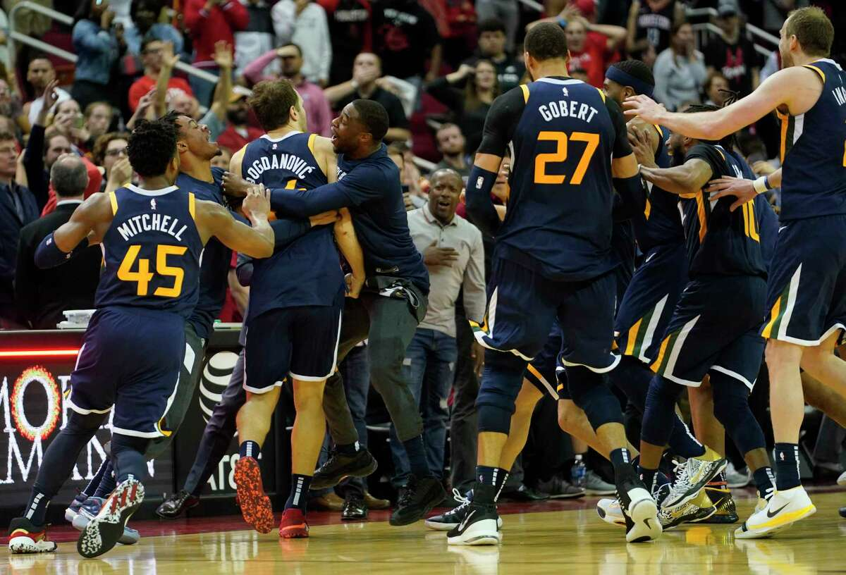 Utah Jazz Bojan Bogdanovic (44) and teammates celebrates his three pointer to win by one over the Houston Rockets Sunday, Feb. 9, 2020, at Toyota Center in Houston.
