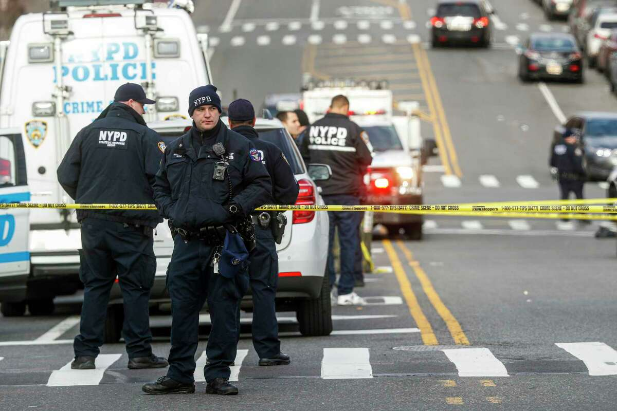 New York City police officers work the scene of a police involved shooting outside the 41st precinct Sunday, Feb. 9, 2020, in New York. (AP Photo/John Minchillo)