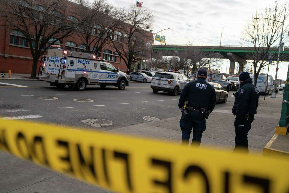 Police officers at the scene of a shooting outside the 41st Precinct station in the Bronx, Feb. 9, 2020. A gunman went on a rampage against the police in the Bronx, officials said on Sunday, carrying out brazen attacks against officers in a patrol van and a precinct station house that left two wounded and the department shaken. (David Dee Delgado/The New York Times)