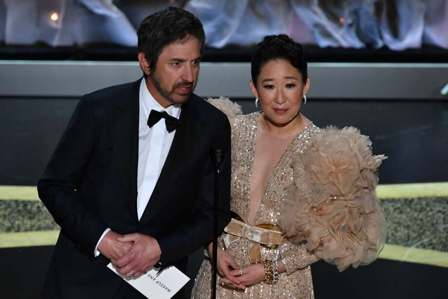 US actor Ray Romano (L) and Canadian actress Sandra Oh speak onstage during the 92nd Oscars at the Dolby Theatre in Hollywood, California on February 9, 2020. (Photo by Mark RALSTON / AFP) (Photo by MARK RALSTON/AFP via Getty Images) Photo: MARK RALSTON/AFP Via Getty Images