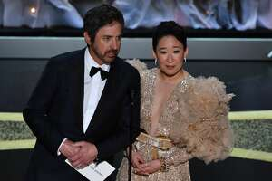 US actor Ray Romano (L) and Canadian actress Sandra Oh speak onstage during the 92nd Oscars at the Dolby Theatre in Hollywood, California on February 9, 2020. (Photo by Mark RALSTON / AFP) (Photo by MARK RALSTON/AFP via Getty Images)