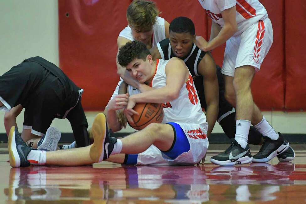 James Thompson of the Albany Academy grabs a loose ball during their game against Rome Free Academy on Sunday, Feb. 9, 2020, in Albany, N.Y. (Paul Buckowski/Times Union)