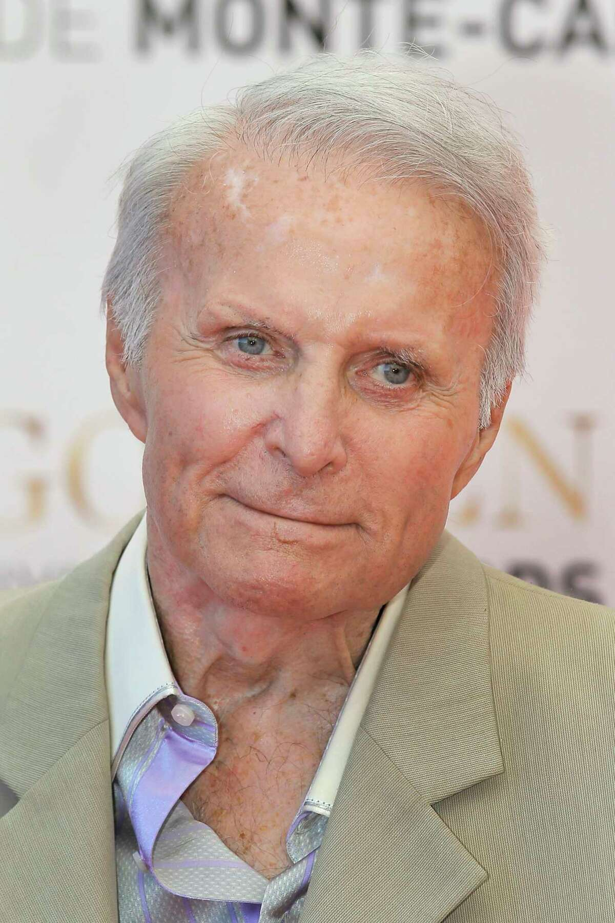 FILE - In this June 13, 2013, file photo, actor Robert Conrad poses for photographers during the closing ceremony of the 2013 Monte Carlo Television Festival, in Monaco. Conrad, the rugged, contentious actor who starred in the hugely popular 1960s television series