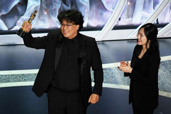 HOLLYWOOD, CALIFORNIA - FEBRUARY 09: (L-R) Bong Joon-ho accepts the International Feature Film award for 'Parasite' with interpreter Sharon Choi onstage during the 92nd Annual Academy Awards at Dolby Theatre on February 09, 2020 in Hollywood, California. (Photo by Kevin Winter/Getty Images)