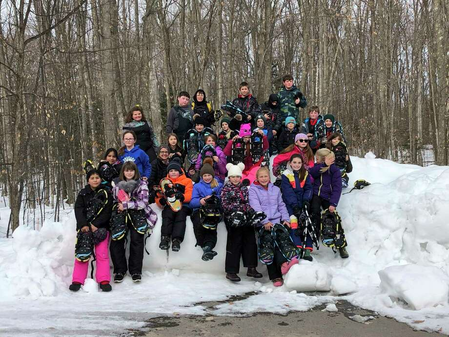 Fifth grade students of Onekama Consolidated Schools hold snowshoes at Sleeping Bear Dunes National Lakeshore park, where they participated in a day of adventure and learning. (Courtesy photo)