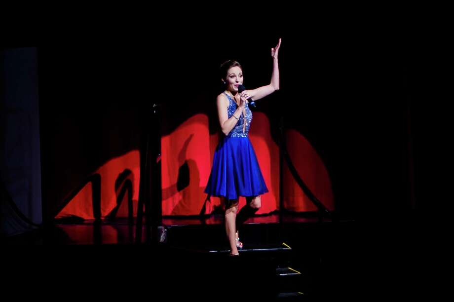 Laura Osnes sings a song during a performance of the Broadway Princess Party Friday evening at Midland Center for the Arts. Osnes portrayed Cinderella in Rodgers and Hammerstein's Cinderella on Broadway. For more photos from the event, go to www.ourmidland.com. (Katy Kildee/kkildee@mdn.net)