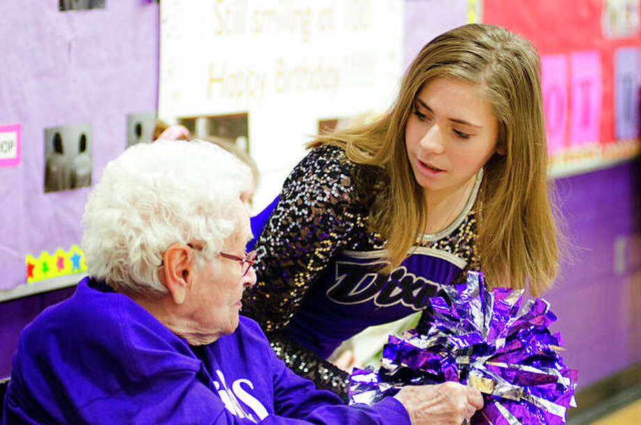 Addie Morley, 15, speaks with 100-year-old Mabel Green along the sidelines at Reagan Middle School while attending a Reagan Middle School basketball game. Green last took her place along the sidelines more than 80 years ago. Photo: Alex T. Paschal | The Telegraph (AP)