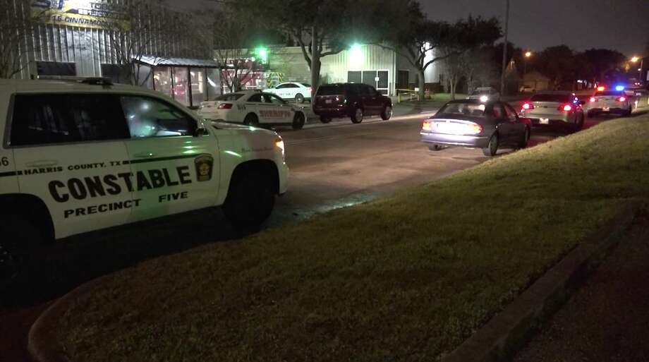 Harris County Sheriff's Office deputies investigate a shooting at a used auto parts shop in the 100 block of Cinnamon Drive near Katy on Monday, Feb. 10, 2020. Photo: OnScene.TV