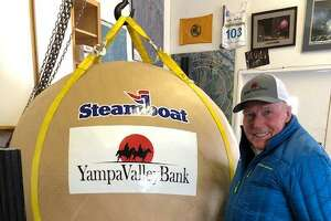 Darien native Tim Borden with the world record firework in his shop.