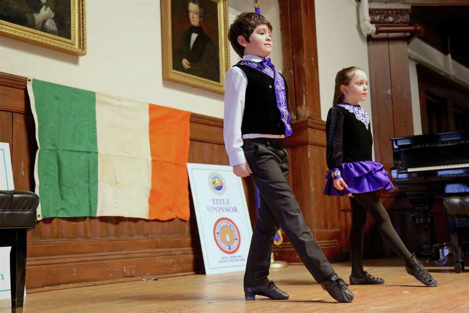 Adam Speer, 7, of Bridgeport, and Hannah Felleman, 6, of Westport, members of the Sheeaun Academy of Irish Dance, perform at the Irish Celebration at Pequot Library on Sunday, Feb. 9, 2020, in Fairfield, Conn. Photo: Jarret Liotta / Jarret Liotta / ©Jarret Liotta 2020