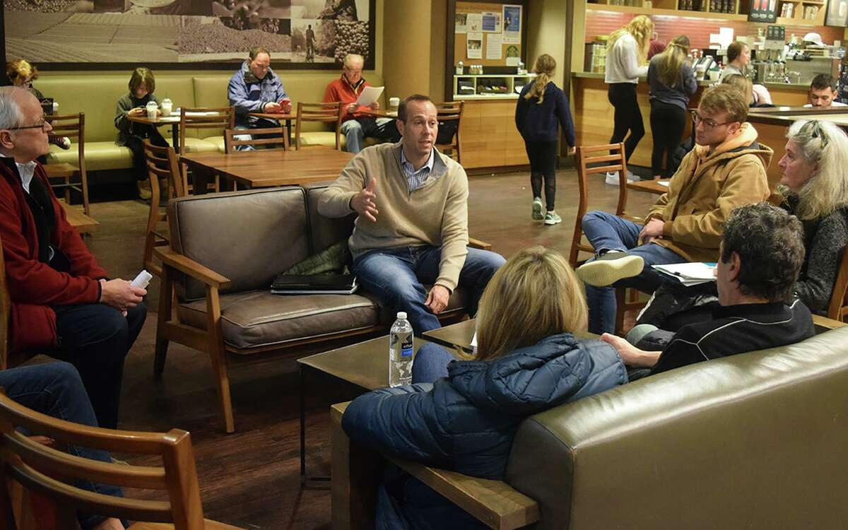 State Rep. Brian Farnen meets with residents at the Starbucks at Fairfield University Bookstore.