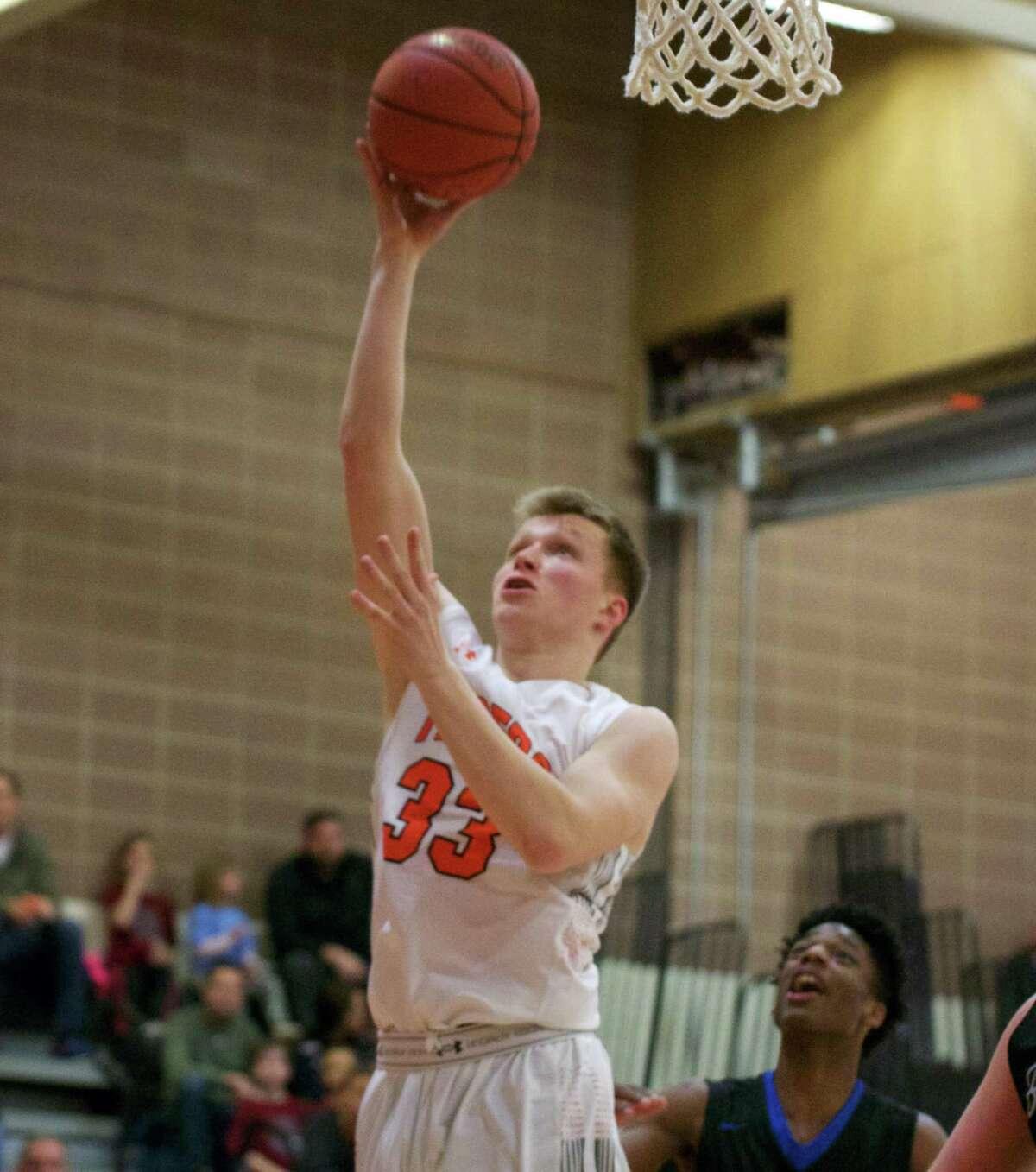 Derek Szpakowski gets open for a shot during a recent Ridgefield boys basketball game.