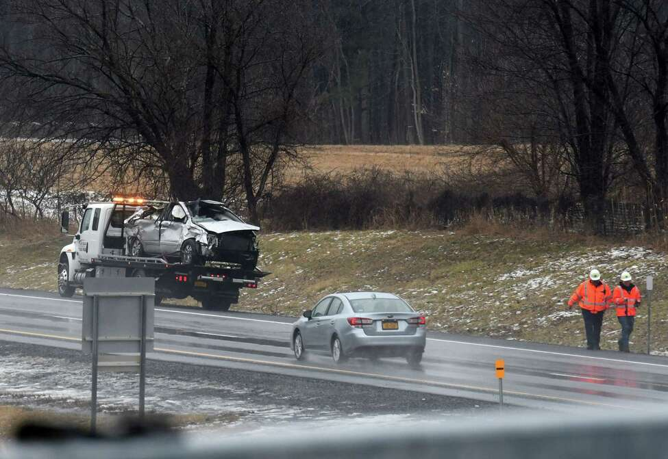 Crews clear the scene of a fatal accident on I-87 southbound just before the Exit 22 offramp on Monday morning, Feb. 10, 2020, in Selkirk, N.Y. One person died.(Will Waldron/Times Union)
