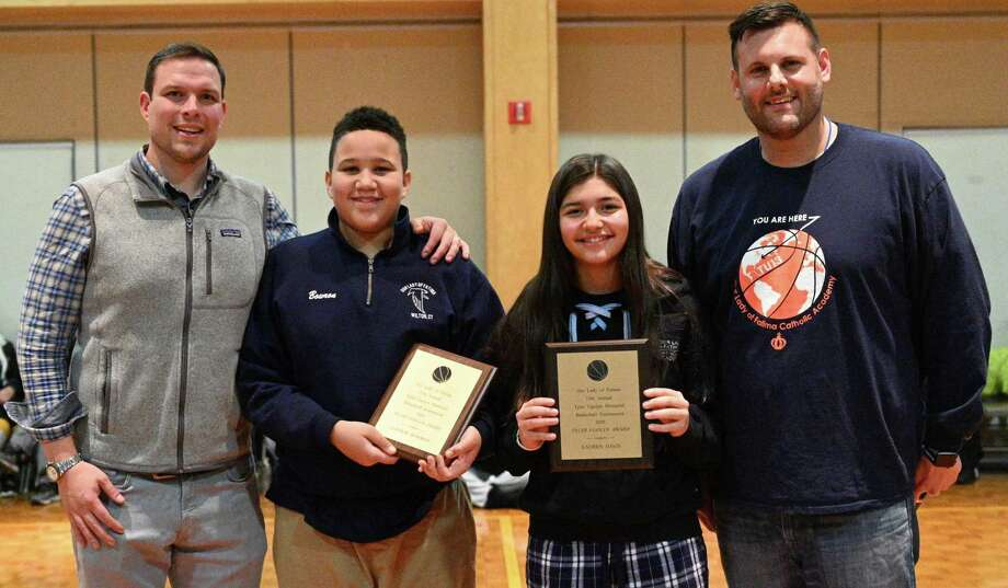 Trevor Ugolyn, left, congratulates award winners Connor Bowron and Lauren Davis at Our Lady of Fatima Academy on Jan. 31. Athletic Director Robert Benedetto is at right. Photo: Contributed Photo / Our Lady Of Fatima Academy / Wilton Bulletin Contributed