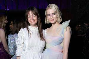 Leith Clark and Lucy Boynton attend the 2020 Vanity Fair Oscar Party hosted by Radhika Jones at Wallis Annenberg Center for the Performing Arts on February 09, 2020 in Beverly Hills, California.