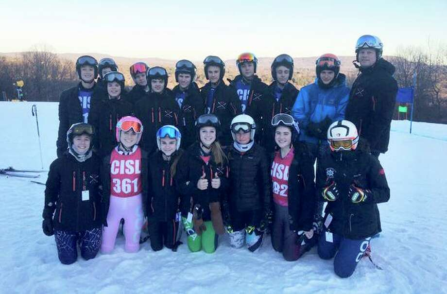 The New Canaan varsity ski team on the slopes of Mt. Southington this season. From left, front row, Natalie Fuhr, Meredith Waldron, Julia Paine, Rory McRory, Hannah Smick, Evie Bradley,and  Paxton Beladino; back row, Josh Vetterli, Josh Snelwar, Ned Ravanesi, Spencer Lore, Braydon Bavoso, Philip Ettinger, Adam Sabo, Lucas Klarman, Myles Gropper, Austin Grillo, and coach Chandler Brill. Photo: Contributed / Hearst Connecticut Media / Hearst Connecticut Media