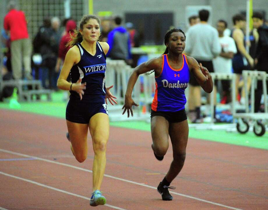 Wilton's Shelby Dejana (left) and Danbury's Florence Dickson compete in the 55-meter dash finals at the FCIAC girls indoor track championship in New Haven last Thursday. Dejana won the race. Photo: Christian Abraham / Hearst Connecticut Media / Connecticut Post